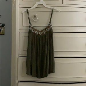 A green tank with cute designs on the top !!